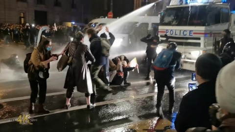 France: Cops use water cannons to disperse gathered protesters...