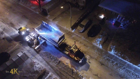 Snowplow video 1 - Drone view of snowblower clearing street at night...