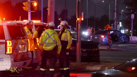 Mississauga: Rainy evening two-car MVC at Derry Road busy corner...