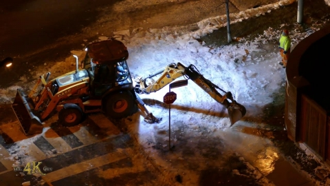Case 580 loader breaking and plowing thick frozen ice buildup over...