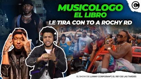 MUSICOLOGO SE LA DEJA CAER FEO A ROCHY RD Y LE ENTRA CON TO...