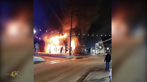 St-Sauveur: Building engulfed in flames before...